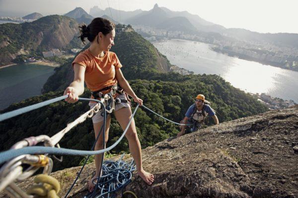 Two friends rock climbing in Rio de Janeiro, Brazil.